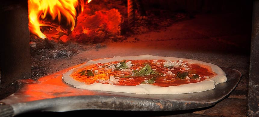 Pizza cooked in wood burning oven - Capri